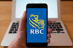 Using iPhone smart phone to display website logo of RBC, Royal Bank of Canada