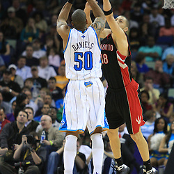 06 February 2009:  New Orleans Hornets guard Antonio Daniels (50) shoots over Toronto Raptors guard Anthony Parker (18) during a NBA game between the New Orleans Hornets and the Toronto Raptors at the New Orleans Arena in New Orleans, LA.
