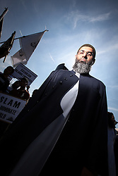 "© Licensed to London News Pictures . FILE PICTURE DATED 30/07/2011 of ANJEM CHOUDARY , as leader of militant Islamist group , Muslims Against Crusaders , during a march through East London at which he called for Sharia law to be imposed in the UK ; as it is reported Choudary has given his backing to a new group named "" IED "" - short for Islamic Emergency Defence , today (Tuesday 25th June 2013) . Photo credit : Joel Goodman/LNP"