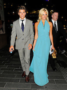 18.JULY.2012. LONDON<br /> <br /> PIXIE LOTT AND BOYFRIEND OLIVER CHESHIRE LEAVING THE ODEON IN LEICESTER SQUARE AFTER ATTENDING THE EUROPEAN PREMIERE OF NEW MOVIE 'BATMAN THE DARK KNIGHT'.<br /> <br /> BYLINE: EDBIMAGEARCHIVE.CO.UK<br /> <br /> *THIS IMAGE IS STRICTLY FOR UK NEWSPAPERS AND MAGAZINES ONLY*<br /> *FOR WORLD WIDE SALES AND WEB USE PLEASE CONTACT EDBIMAGEARCHIVE - 0208 954 5968*