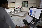 Organic cotton being cut in to shape at Pratibha Syntax factory, where organic cotton is being used to make clothes, Indore, India.