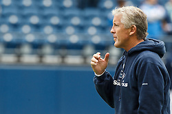 September 26, 2010; Seattle, WA, USA;  Seattle Seahawks head coach Pete Carroll watches his team warm up before the game against the San Diego Chargers at Qwest Field.