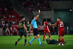 September 20, 2018 - Piraeus, Attiki, Greece - Referee is pointed out to Kostas Tsimikas (no 21) of Olympiacos the yellow card. (Credit Image: © Dimitrios Karvountzis/Pacific Press via ZUMA Wire)