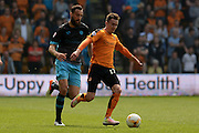 Sheffield Wednesday striker Atdhe Nuhiu tracks Wolverhampton Wanderers midfielder Jed Wallace during the Sky Bet Championship match between Wolverhampton Wanderers and Sheffield Wednesday at Molineux, Wolverhampton, England on 7 May 2016. Photo by Alan Franklin.