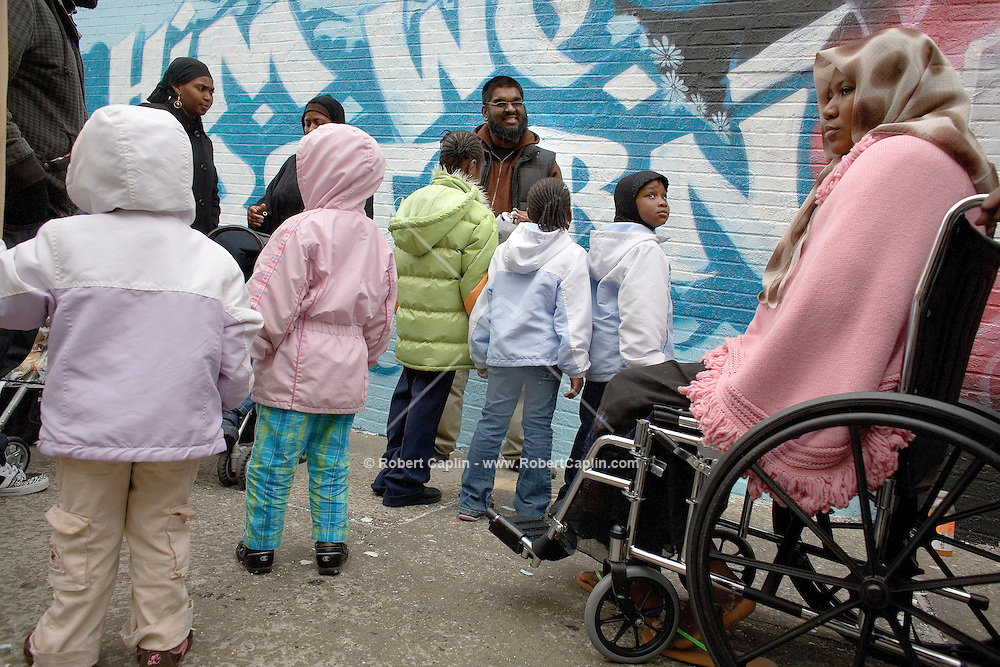"""Renowned graffitti artist Mohammed Ali AKA """"aerosole Arabic"""" paints a mural in dedication to victims of the Bronx fire. Members of the Magassa family were on hand to help paint and witness the creation of the mural dedicated to their lost siblings. The mural is located at 56 East Mt. Eden Avenue at Townsend Avenue in The Bronx."""