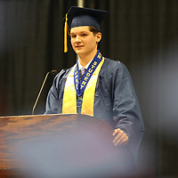 Nettleton High School Valedictorian Cayson Housley addresses his classmates during their graduation ceremony Saturday morning.