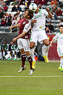 March 30th, 2013 Commerce City, CO - Colorado Rapids midfielder Brian Mullan (11) and Portland Timbers forward Ryan Johnson (9) both attempt to head the ball in the first half of the MLS match between the Portland Timbers and the Colorado Rapids at Dick's Sporting Goods Park in Commerce City, CO