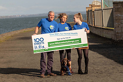 Pictured: Maria Lyle, Scott and Jenny Hastings with Parker the dog<br />