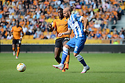 Bruno Saltor plays the ball away from Sheyi Ojo during the Sky Bet Championship match between Wolverhampton Wanderers and Brighton and Hove Albion at Molineux, Wolverhampton, England on 19 September 2015. Photo by Alan Franklin.