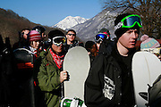 Snow-boarders queue for the chairlift near Russia's Black Sea coastal city of Sochi. ..The resort, perched on the foot of snow-capped mountains, is bidding to host the 2014 Winter Olympics.