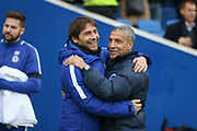 Chelsea Manager Antonio Conte and Brighton and Hove Albion manager Chris Hughton during the Premier League match between Brighton and Hove Albion and Chelsea at the American Express Community Stadium, Brighton and Hove, England on 20 January 2018. Photo by Phil Duncan.