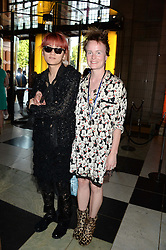 Left to right, RYAN LO and LOUISE GRAY at the opening of Club To Catwalk: London Fashion In The 1980's an exhibition at The V&A Museum, London on 8th July 2013.