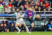 Barcelona defender Jordi Alba (18) tussles with Liverpool striker Mohamed Salah (11) during the Champions League semi-final leg 1 of 2 match between Barcelona and Liverpool at Camp Nou, Barcelona, Spain on 1 May 2019.