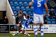 Colchester United defender Kane Vincent-Young (22) makes a tackle Lincoln City defender James Wilson (15) during the EFL Sky Bet League 2 match between Colchester United and Lincoln City at the JobServe Community Stadium, Colchester, England on 27 October 2018.