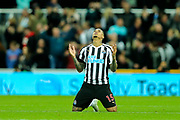 Kenedy (#15) of Newcastle United sinks to his knees and prays following Newcastle United's 1-0 win against Watford in the Premier League match between Newcastle United and Watford at St. James's Park, Newcastle, England on 3 November 2018.