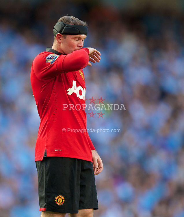 MANCHESTER, ENGLAND - Sunday, September 22, 2013: Manchester United's Wayne Rooney during the Premiership match against Manchester City at the City of Manchester Stadium. (Pic by David Rawcliffe/Propaganda)
