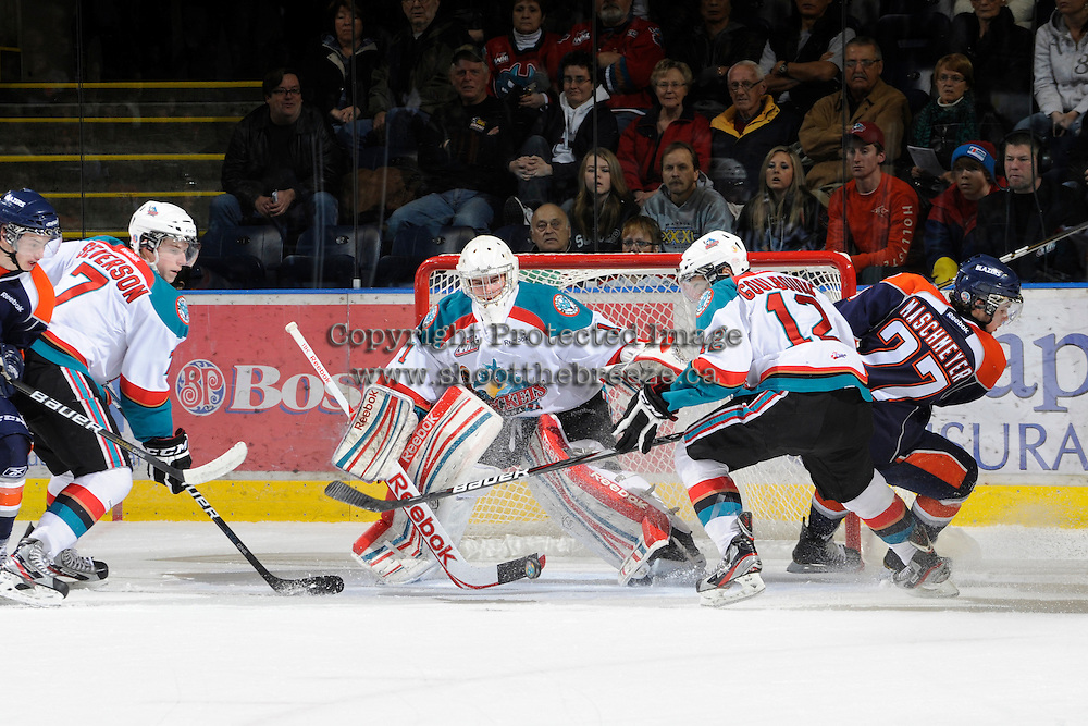 KELOWNA, CANADA, FEBRUARY 11: Adam Brown #1 of the Kelowna Rockets makes a save as the Kamloops Blazers visit the Kelowna Rockets on February 11, 2012 at Prospera Place in Kelowna, British Columbia, Canada (Photo by Marissa Baecker/Shoot the Breeze) *** Local Caption ***