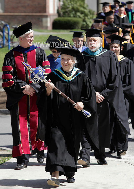 Grand Marshall Nancy J. Nielson leads the processional during the installation ceremony for new SUNY New Paltz president Donald P. Christian on Friday, April 13, 2012.