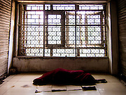 17th April 2016, New Delhi. A woman sleeps on the floor of a shopping complex in New Delhi, India on the 17th April 2016<br />