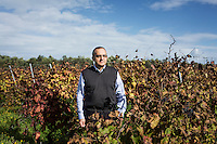 """GUAGNANO, ITALY - 10 NOVEMBER 2016: Gianvito Rizzo (53), inventor of the sommelier courses at Lecce prison and chief executive officer at the Feudi di Guagnano, the wine cellar that offered their wines for the classes, poses for a portrait in the vineyard of Camarda of the wine house Feudi di San Guaganano, where the wine """"Le Camarde"""" is produced, in Guagnano near Lecce, Italy, on November 10th 2016.<br /> <br /> Here a group of ten high-security female inmates and aspiring sommeliers , some of which are married to mafia mobsters or have been convicted for criminal association (crimes carrying up to to decades of jail time), are taking a course of eight lessons to learn how to taste, choose and serve local wines.<br /> <br /> The classes are part of a wide-ranging educational program to teach inmates new professional skills, as well as help them develop a bond with the region they live in.<br /> <br /> Since the 1970s, Italian norms have been providing for reeducation and a personalized approach to detention. However, the lack of funds to rehabilitate inmates, alongside the chronic overcrowding of Italian prisons, have created a reality of thousands of incarcerated men and women with little to do all day long. Especially those with a serious criminal record, experts said, need dedicated therapy and professionals who can help them."""