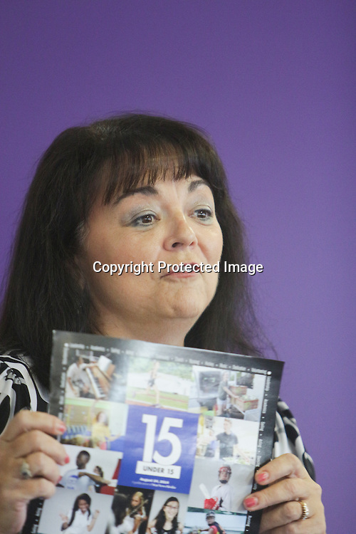 Star News Editor Pam Sander shows off the special section front for the 15 Under 15 project Sunday September 14, 2014 at Jungle Rapids in Wilmington, N.C. (Jason A. Frizzelle)