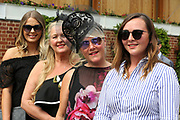 Four fashionable and elegant ladies looking forward to the third day of the Dante Festival at York Racecourse, York, United Kingdom on 17 May 2019.