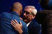 Tony Evers greets family during the Election Night watch party at the Orpheum Theater in Madison, Wisconsin, Wednesday, Nov. 7, 2018.