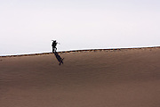 Hikers in sand dunes in Death Valley National Park, California
