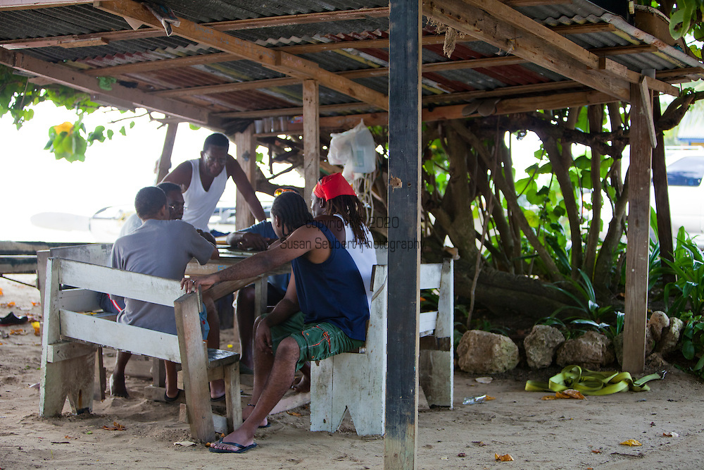 The game of dominos is played a lot in the Caribbean, especially in Barbados and Jamaica.  Here a group of local watermen enjoy an afternoon game under a tree at Cobbler's Cove, a popular beach on the Gold Coast and adjacent to the elegant hotel, Cobblers Cove.  The beach is also known to the locals as Cholera Beach, leftover from the Cholera epidemic of the mid-19th century.
