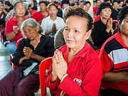 28 APRIL 2014 - BANGKOK, THAILAND: Red Shirts pray at the funeral for Kamol Duangphasuk, 45, in Bangkok. Kamol was a popular poet who wrote under the pen name Mai Nueng Kor Kunthee. Kamol had been writing since the 1980s and was an outspoken critic of the 2006 coup that deposed Thaksin Shinawatra. After the 2010 military crackdown against the Red Shirts he went into temporary self imposed exile fearing for his safety. After he returned to Thailand he organized weekly protests against Thailand's Lese Majeste laws, which he said were being used to stifle dissent. Kamol was shot and murdered on April 23. The assailants are still at large but the murder is thought to be political.     PHOTO BY JACK KURTZ