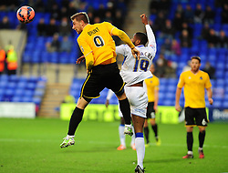 Bristol Rovers' Ryan Brunt is challenged by Tranmere Rovers's Janoi Donacien - Photo mandatory by-line: Neil Brookman/JMP - Mobile: 07966 386802 - 08/11/2014 - SPORT - Football - Birkenhead - Prenton Park - Tranmere Rovers v Bristol Rovers - FA Cup - Round One