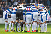 Queens Park Rangers players group huddle before the EFL Sky Bet Championship match between Queens Park Rangers and Stoke City at the Loftus Road Stadium, London, England on 9 March 2019.