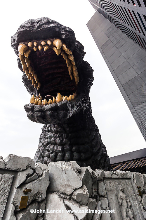 Godzilla at Hotel Gracery  - Each Tokyo neighborhood has its own special flavor, but it is hard to top Shinjuku for its sheer variety of flavors, and smells.  Godzilla has starred in countless films, both cheesy and exciting. Godzilla himself emerges at the Shinjuku Toho Building.  Toho was the movie studio that produced the Godzilla films, and so it is only fitting that they should use one of their most famous sttars to adorn thei new building.  Godzilla was added to the outdoor terrace on the eighth floor at 12 meters tall.  Passersby on ground level are treated to the dynamic illusion of Godzilla breaking its way through the buildings some 40 meters above.  Hotel Gracery is in the same building and features special Godzilla View Rooms, commanding a view of Godzilla's head, as well as a Godzilla Room featuring a special layout inspired by the Godzilla films.  Unlike in the movies, when people were fleeing Godzilla in panic, on the contrary, have been flocking to Shinjuku Kabukicho to visit Godzilla ever since it the place opened.