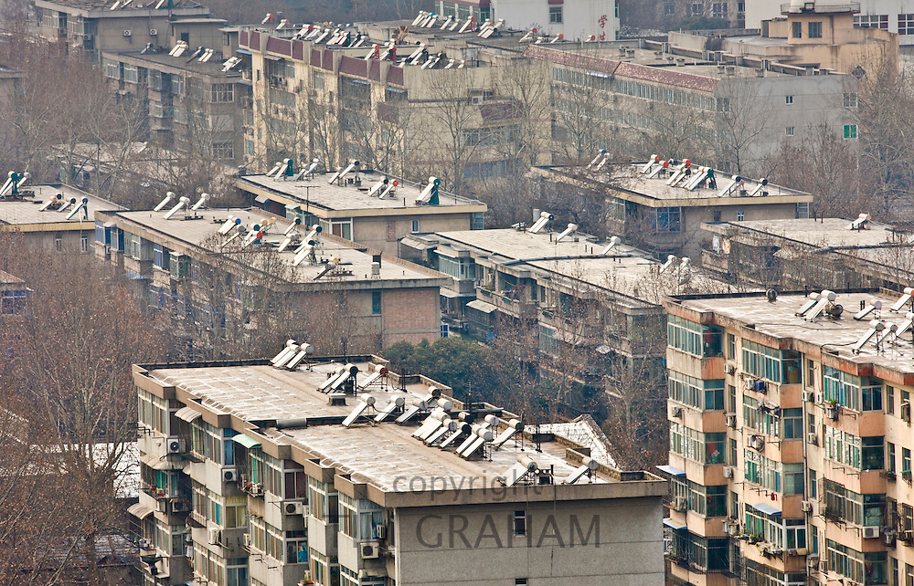 Solar panels on rooftops of apartment blocks in Xian seen from the Dayan Pagoda, China