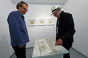 "Neufelden, Austria. HEIM.ART®-Station by Joachim Eckl (l.)<br /> Exhibition ""Zeichen der Erinnerung (Signs of Memory)"".<br /> Pictures from Egypt by Karl-Heinz Tritschler (r.)"