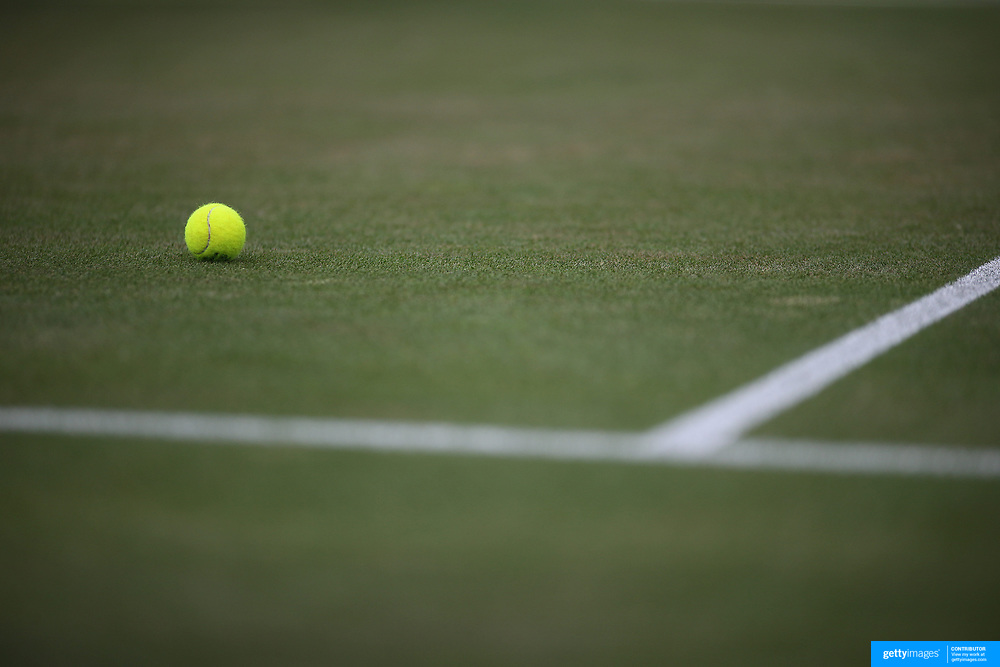 LONDON, ENGLAND - JULY 13:  A tennis ball on the  grass on an outer court during the Wimbledon Lawn Tennis Championships at the All England Lawn Tennis and Croquet Club at Wimbledon on July 13, 2017 in London, England. (Photo by Tim Clayton/Corbis via Getty Images)