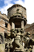 Mermaid with a mirror, brushing her hair, on the King's fountain, built 1537, in the inner courtyard of Linlithgow Palace, built 15th century under king James I, and rebuilt 1618-22 by king James VI, a royal palace and residence for Scottish monarchs, in West Lothian, Scotland. The fountain was commissioned by James V and is the oldest fountain in Britain. It was restored in 2005. Mary Queen of Scots was born here. The palace was a resting place for Stuart royalty travelling between Edinburgh and Stirling. The Renaissance style palace was burned in 1746 and has since been restored and is now run by Historic Environment Scotland. Picture by Manuel Cohen