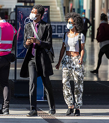 © Licensed to London News Pictures. 20/07/2020. London, UK. Commuters arrive in Westminster as they head back to their offices in central London as Marks and Spencers is expected to announce that hundreds of jobs will go as shops on the High Streets still remain quiet after the easing of the Coronavirus restrictions. Last week Prime Minister Boris Johnson urged Britons to return back to working in offices to help service industries and the economic recovery. Photo credit: Alex Lentati/LNP