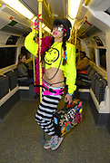 Namalee Bolle editor of Super Super Magazine, wearing New Rave styles on the underground, London December 2006