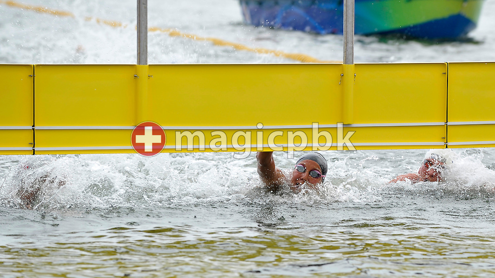Swann OBERSON (C) of Switzerland touches first in the Women's 5km Open Water Swimming event during the 14th FINA World Aquatics Championships at the Jinshan City Beach in Shanghai, China, Friday, July 22, 2011. (Photo by MAGICPBK)