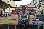 Flores Namibia at the Rafael Trejo, the Gimnasio de Boxeo. She considers it as her spiritual home<br /> <br /> The Cuban boxing has a centennial long prestigious history written by exceptional champions, artists of the ring, whose legendary exploits , continue to live in the stories of fans. In 1962 Cuba had abolished professionalism in sports. Two years ago, driven by economic interests and attempt to stop the bleeding of athletes on the run from the island, sports authorities have announced participation in world boxing championship, the World Series of Boxing (WSB), which are not however a professional circuit because they remain part of the Olympic boxing. Thanks to a law passed a few years ago, with new economic conditions for the Cuban athletes, now, in addition to the contributions they receive from the state, the Cuban boxers will earn from their sport, 80% of the proceeds from participation in<br /> international sporting events. Another revolution in the land of revolutionary socialist utopia , now more and more on the road of the disintegration waiting for another revolution in the Cuban boxing that will allow women to have a women&rsquo;s boxing team. Revolution for which for years has fought Namibia Flores whose dream is to participate in the Olympics with the colors of his country. A fight against time for the forty Namibia Flores. A dream that will probably remain so for reached the age limit.<br /> Namibia has refused to fight for the US teams. Most likely it will not fight the next Olympics in Rio but it is determined to help future Cuban fighters to practice the sport which they love.