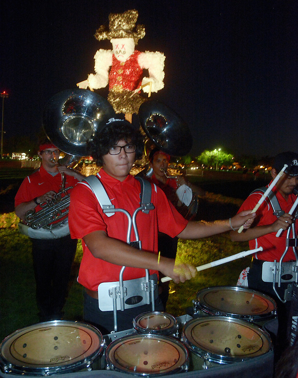 gbs090816q/SPORTS -- David McRee, a UNM freshman of Los Lunas, plays the tenor drums with the New Mexico University Spirit Band before New Mexico State University's mascot, Pistol Pete, is burned in effigy on Johnson Field on the University of New Mexico campus during the Red Rally on Thursday, September 8, 2016. (Greg Sorber/Albuquerque Journal)
