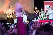 Jeremy Corbyn (pictured with the other speakers taking the applause) holds a campaign meeting as part of his Labour Party leadership challenge - with support of Ken Livingstone at the Camden Town Hall, London, UK 03 Aug 2015