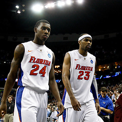 Mar 26, 2011; New Orleans, LA; Florida Gators guard Casey Prather (24) and forward Alex Tyus (23) walk off the court following a loss to the Butler Bulldogs in the semifinals of the southeast regional of the 2011 NCAA men's basketball tournament at New Orleans Arena. Butler defeated Florida 74-71.  Mandatory Credit: Derick E. Hingle