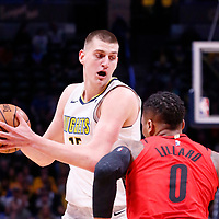09 April 2018: Portland Trail Blazers guard Damian Lillard (0) defends on Denver Nuggets center Nikola Jokic (15) during the Denver Nuggets 88-82 victory over the Portland Trail Blazers, at the Pepsi Center, Denver, Colorado, USA.