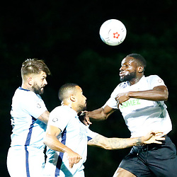 SEPTEMBER 12:  Top of the table Dover Athletic FChost eighth place Boreham Wood FC in Conference Premier at Crabble Stadium in Dover, England. The visitors, Boreham Wood  ran out winners a goal to nothing. Dover's defender Manny Parry wins the ball in the air. (Photo by Matt Bristow/mattbristow.net)
