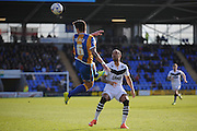 Ian Black of Shrewsbury Town heads clear from Byron Moore of Port Vale FC during the Sky Bet League 1 match between Shrewsbury Town and Port Vale at Greenhous Meadow, Shrewsbury, England on 25 March 2016. Photo by Mike Sheridan.