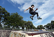 Donovan Kucera, 16, attempts a trick while skating Thursday afternoon at Pier Park in Grand Island. (Independent/Matt Dixon)