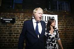 © Licensed to London News Pictures. 23/06/2016. London, UK. Former Mayor of London BORIS JOHNSON arrives at Hanover Primary School in north London with his wife MARINA WHEELER, to cast his vote in the EU referendum. Photo credit: Tolga Akmen/LNP