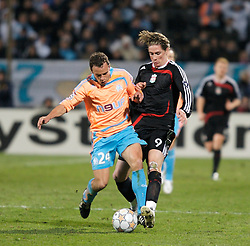 MARSEILLE, FRANCE - Tuesday, December 11, 2007: Liverpool's Fernando Torres and Olympique de Marseille's Laurent Bonnart during the final UEFA Champions League Group A match at the Stade Velodrome. (Photo by David Rawcliffe/Propaganda)